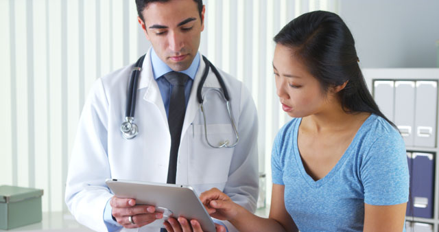 Young adult talks to medical professional