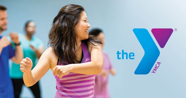 Woman exercising at YMCA with logo to right