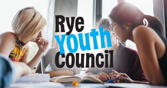 Teens Around Table with Rye Youth Counsel Logo in Middle